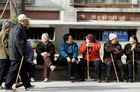 A group of elderly Chinese people enjoys