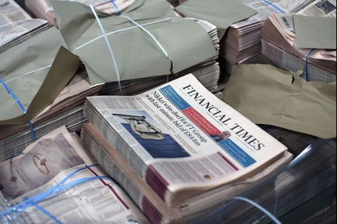 Bundles Of The Financial Times Newspaper Arrive At A Distribution Centre And Are Delivered Around London
