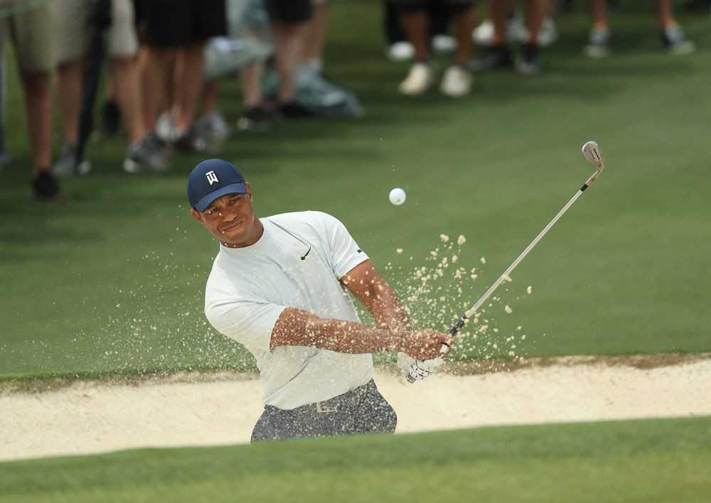 ca7a4b13 Tiger Woods plays a shot from a bunker on the second hole during the second  round