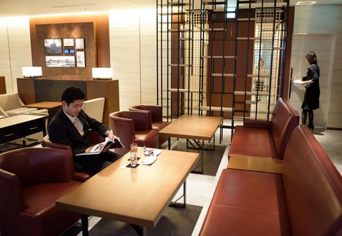 A customer rests at the View Gold Lounge inside Tokyo Station