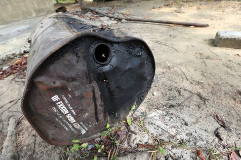 An abandoned oil drum sits in Bodo.