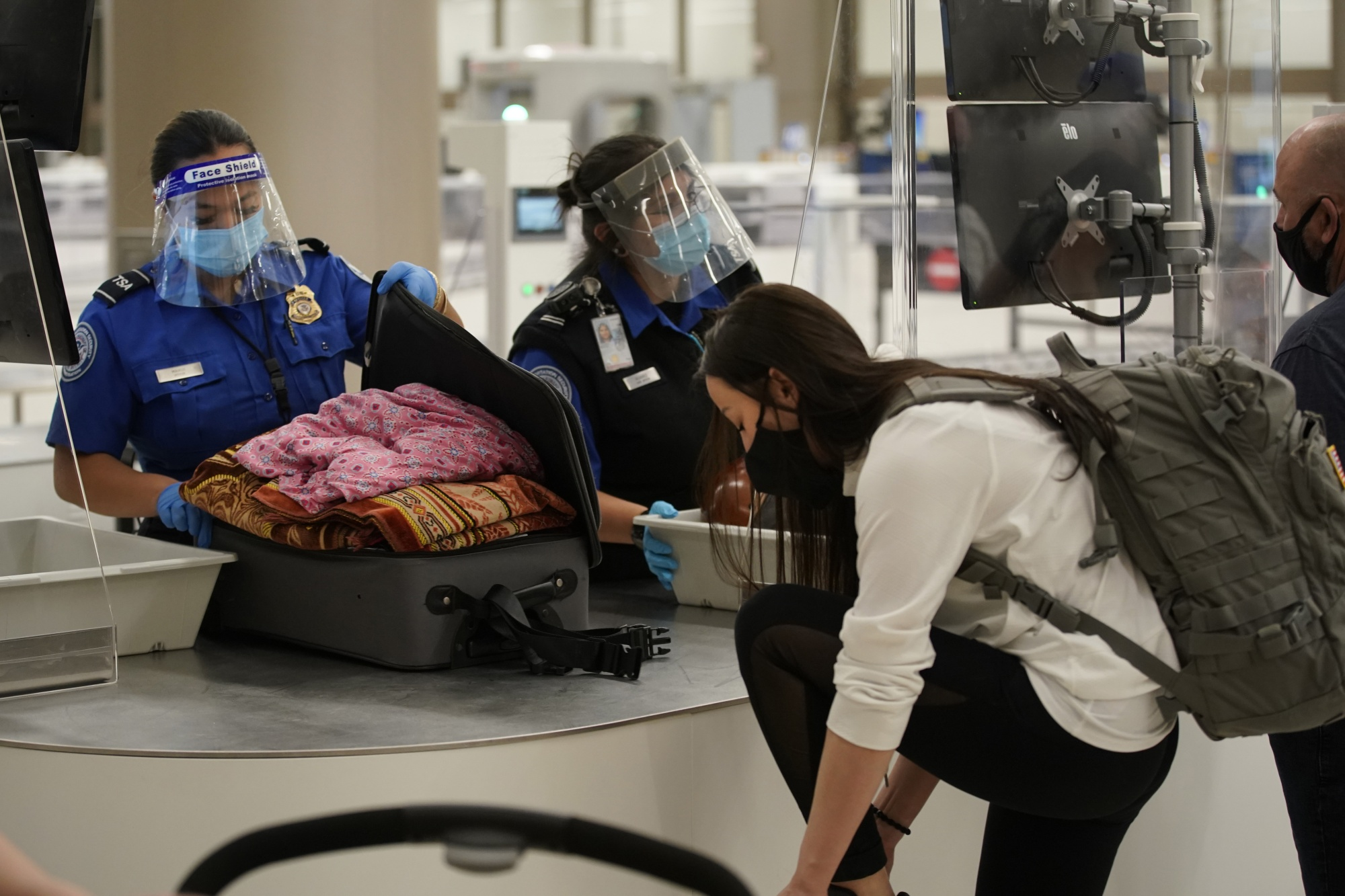 TSAagents check the luggage of a travleres at the security screening center at theSalt Lake City International Airport in Salt Lake City, Utah, on Sept. 15.