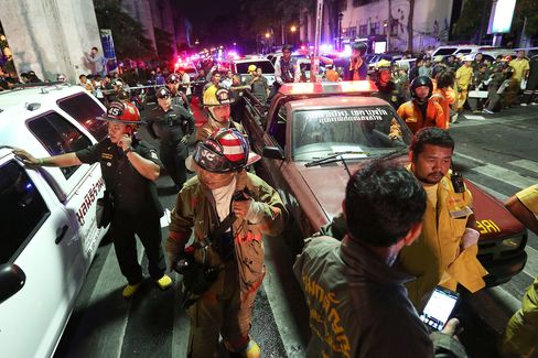 Emergency vehicles and members of the Fire Department arrive to assist following an explosion at the Ratchaprasong intersection in Bangkok on Aug. 17. Photographer: Dario Pignatelli/Bloomberg