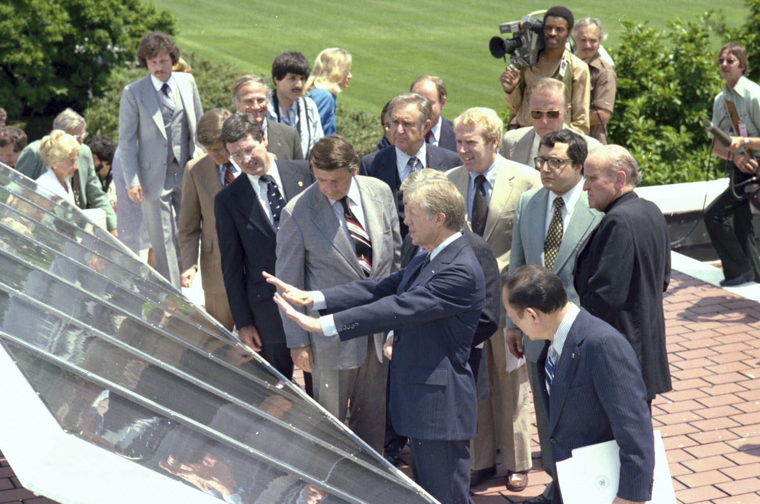 President Jimmy Carter shows off new solar panels on the West Wing that would provide hot water for the White House.