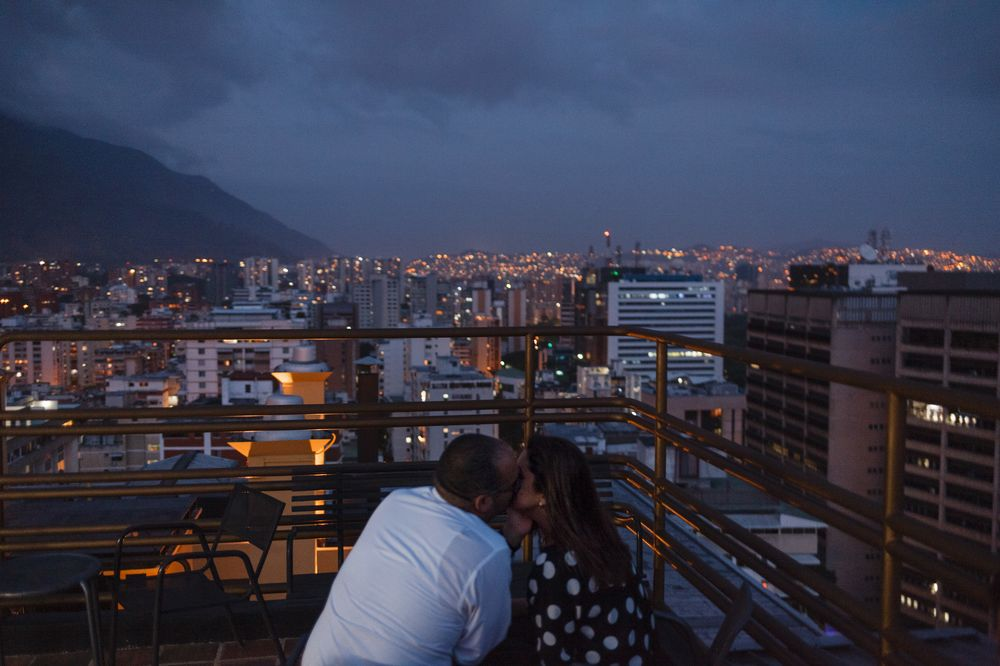 Romance at the 360 Caracas rooftop bar, overlooking the lights—which are on, for the moment—of the capital.