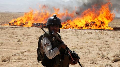 Afghani security forces burn 21 tons of the narcotic drug in Herat, Afghanistan.