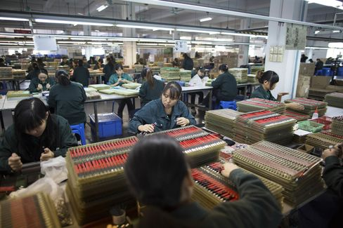 Workers assemble mechanical pencils at s stationery factory in Guangzhou.