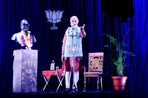 Modi appears in hologram form during his 2014 campaign.