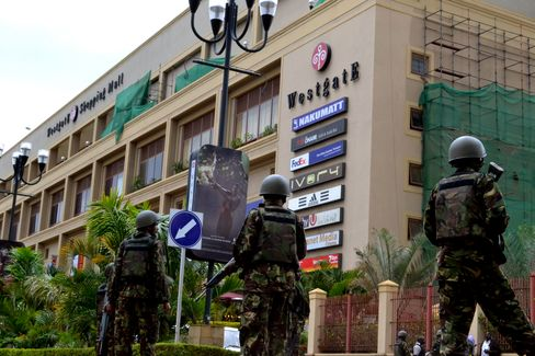 Kenyan Defence Forces stand outside the Westgate Mall during a rescue operation at the site of a terrorist attack by Al-Shahaab militants in Nairobi, on Sept, 21, 2013. Photographer: Jeff Angote/Nation Media/Gallo Images via Getty Images