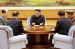 North Korean leader Kim Jong-Un attends a meeting with a committee of the Workers' Party of Korea about the test of a hydrogen bomb, at an unknown location.