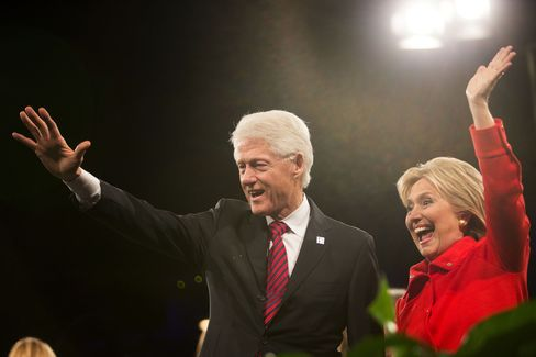 Hillary Clinton waves to supporters with her husband, former President Bill Clinton, at the conclusion of the Jefferson-Jackson Dinner in Des Moines, Iowa, on Oct. 24, 2015.