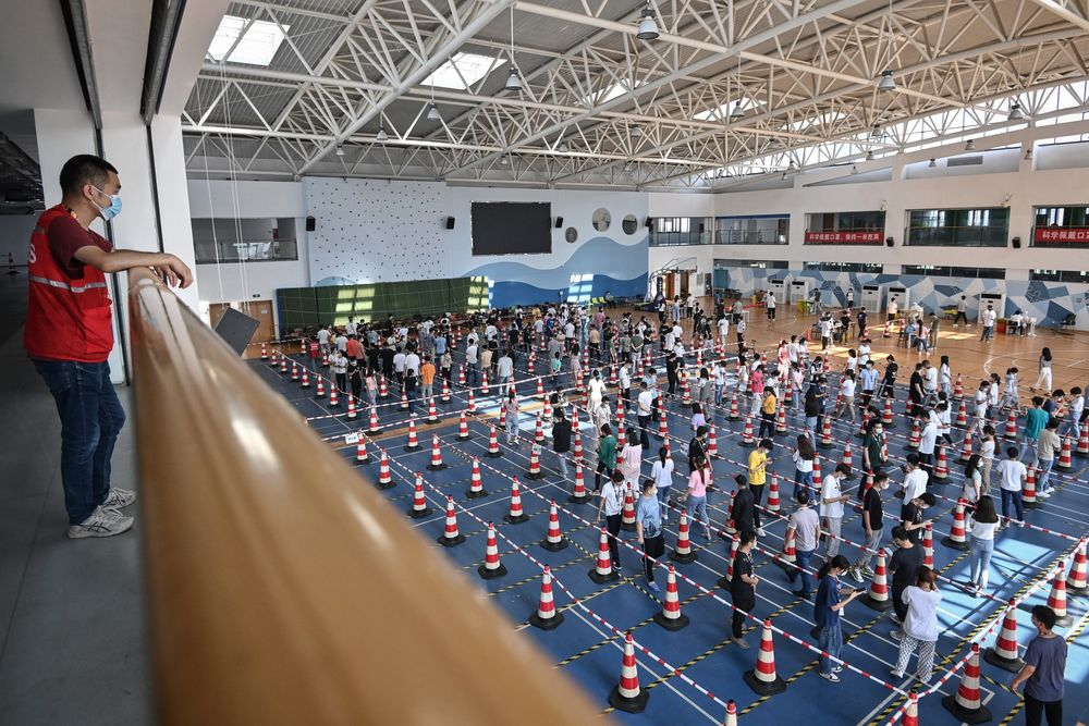 covid-19 test  at a company gym in Wuhan on Aug. 5.