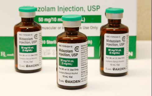 This July 25, 2014 file photo shows bottles of the sedative midazolam at a hospital pharmacy in Oklahoma City.