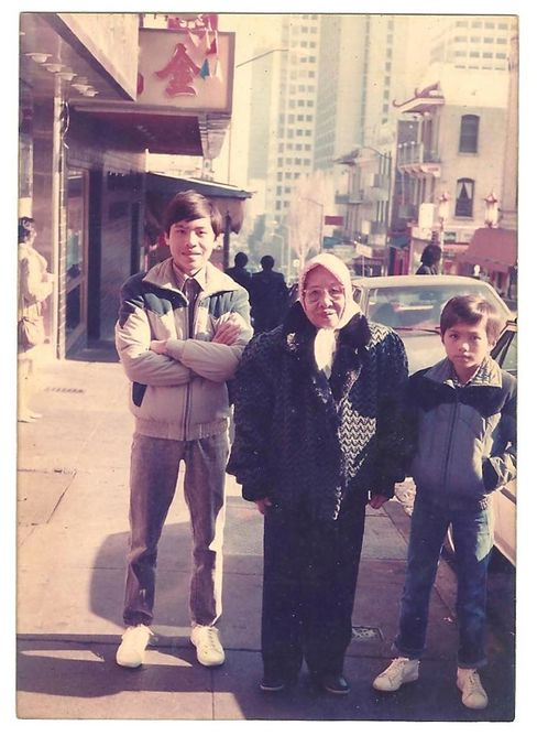 Tran (right) with his grandmother and brother in San Francisco.