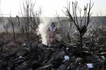 Rescue workers search the scene where an Ukrainian plane crashed in Shahedshahr, southwest of the capital Tehran on Jan. 8, 2020.