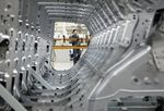 A worker operates the assembly line at the Changan Ford Mazda Plant in Nanjing, China, on Thursday, July 9, 2009. Ford Motor Co. said it intends to outpace industry wide sales in China, the world's fastest-growing major auto market, helped by demand for the new Fiesta.