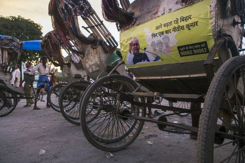An advertisement for opposition co-leader Nitish Kumar is displayed on the back of a rickshaw in Patna, Bihar. Photographer: Prashanth Vishwanathan/Bloomberg