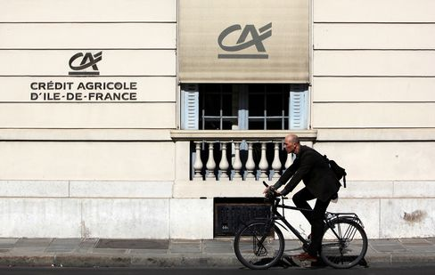 A Cyclist Passes A Branch Of Credit Agricole SA In Paris, France