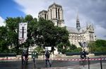 French police officials gather at a cordonned-off area at Notre-Dame Cathederal in Paris on June 6, 2017. A French police officer has shot and injured a man who attacked him with a hammer outside Paris's Notre-Dame cathedral authorities said. Police sealed off the area in front of the cathedral, where the attacker lay injured on the ground. / AFP PHOTO / Martin BUREAU (Photo credit should read MARTIN BUREAU/AFP/Getty Images)