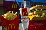 A McDonald's Corp. Big Mac meal is arranged for a photograph outside of a restaurant in San Francisco, California, U.S., on Wednesday, Jan. 22, 2014. McDonald's Corp., the world's largest restaurant chain, posted fourth-quarter profit that was little changed from a year earlier as U.S. same-store sales fell amid shaky consumer confidence and increased competition.
