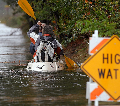 Terry and Derek Ballingall get creative to make a convenience-store run in high waters from Hurricane Sandy in Poquoson, Va., on Oct. 28