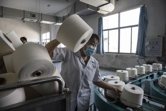 Covid Keeps Workers in Factories, Distorting China Spending