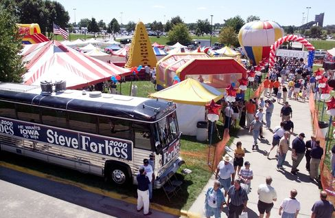 Republican voters make their way through the recreational area set up by Republican presidential candidate Steve Forbes on the grounds of Iowa State University 14 August 1999 in Ames, Iowa.