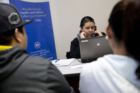 A Counselor Assists Residents to Sign up for Health Coverage