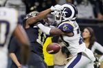 Tommylee Lewis of the New Orleans Saints drops a pass broken up by Nickell Robey-Coleman of the Los Angeles Rams during the fourth quarter in the NFC Championship game on Jan. 20, in New Orleans.