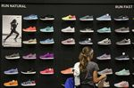 A customer browses a wall of Nike Inc. sneakers on display for sale at Dick's Sporting Goods Inc. store in Sterling Heights, Michigan, U.S., on Thursday, Aug. 18, 2016.
