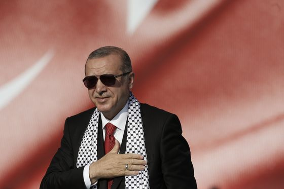 How Markets Won: Erdogan Concedes a Hated Rate Hike to Save Lira