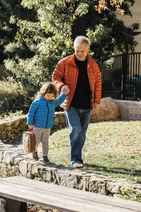 Rick Ridgeway, vice president of public engagement, arrives with his granddaughter at Patagonia for a day of work and play.