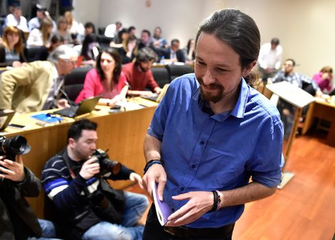 Leader of left wing party Podemos Pablo Iglesias leaves a press conference at the Spanish parliament in Madrid