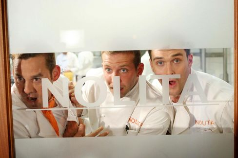 A still from the TV series Kitchen Confidential, which aired in 2005. From left to right: Nicholas Brendon, Bradley Cooper, and Owain Yeoman.
