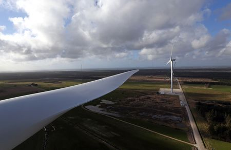 The giant blade of a Vestas V126, left, is as long as the wingspan of an Airbus A380 jumbo jet.