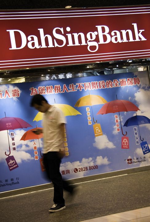 Hong Kong Takeovers Loom Large With Banks Lending Yuan
