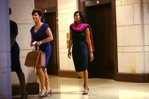 Cheryl Mills (right), Hillary Clinton's chief of staff at the State Department, arrives for a closed-door deposition before the House Select Committee on Benghazi on Sept. 3, 2015, on Capitol Hill in Washington.