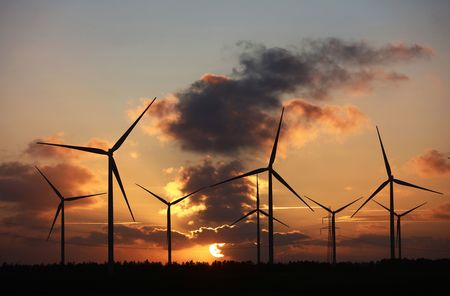 Where some see beauty, others see blot. The sun sets beyond wind turbines near Fjerritslev, Denmark.