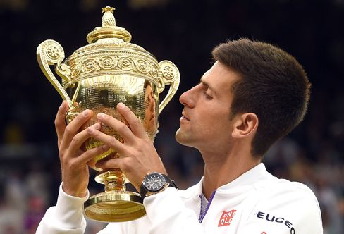 Taking the cup with a Seiko Astron Novak Djokovic Limited Edition on his wrist.