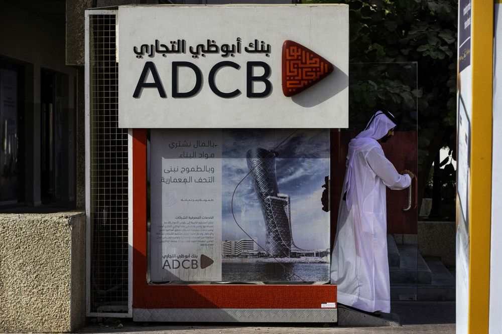 abu dhabi s bank merger is seen to result in 1 000 job cuts bloomberg