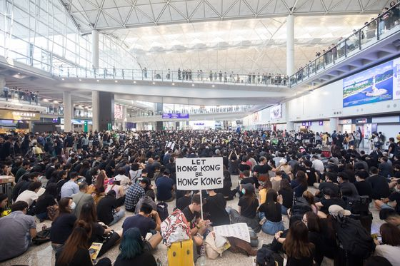 Hong Kong Protesters Clash With Police, Occupy Airport