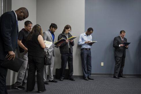 Job seekers wait in line to enter the Choice Career Fair in San Antonio, Texas, U.S.