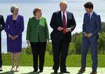 Theresa May, Angela Merkel, Donald Trump, and Justin Trudeau.