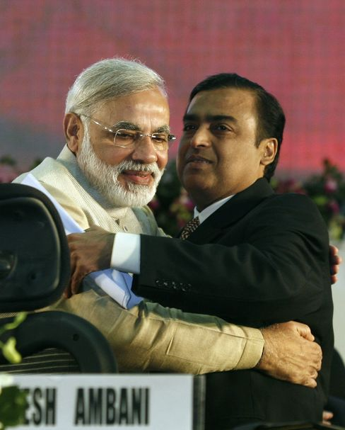 Modi embraces Mukesh Ambani, the richest man in India, in 2011.