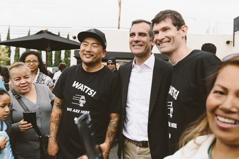 Los Angeles Mayor Garcetti (center) with chefs Choi (left) and Patterson of Locol.