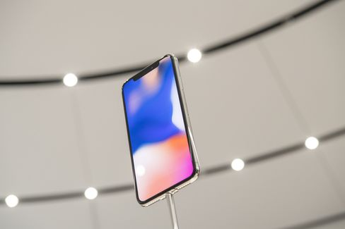The Apple Inc. iPhone X is displayed during an event at the Steve Jobs Theater in Cupertino, California, U.S., on Tuesday, Sept. 12, 2017.