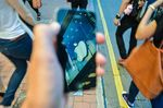 HONG KONG, HONG KONG SAR, CHINA - 2013/07/30: The Apple Store's logo is reflected in the touch screen of an iPhone in Hong Kong.