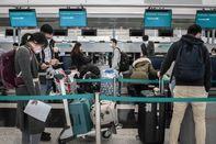 Reaction In Hong Kong As WHO Considers Emergency Decree