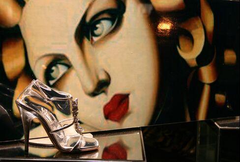 A Giuseppe Zanotti Shoe Sits in a Store Window in New York