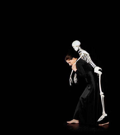 Carrying the Skeleton I, 2008. Some of Abramovic's photographs, like this one, are staged rather than shot during actual performances.